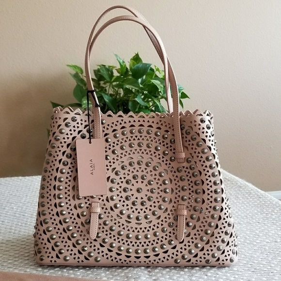 d9057cc24 Alaia Sable studded laser cut tote. Listing Price: $2,150.00